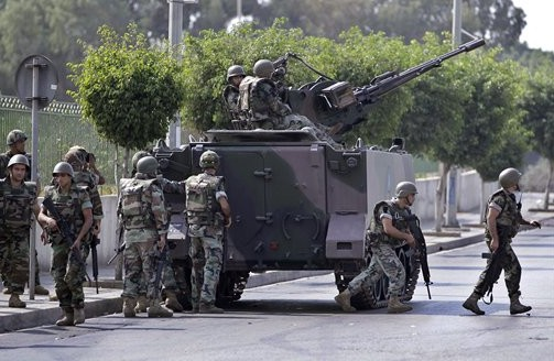Lebanese Army soldiers deploy after overnight clashes between Sunni and Shiite gunmen in Beirut, Lebanon, Oct. 22,