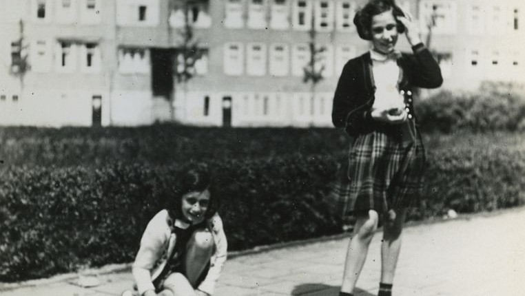 Anne Frank (L) plays with her friend Hanneli Goslar (R) on the Merwedeplein square in Amsterdam, May 1941. (AP Photo/Anne Frank House Amsterdam/Anne Frank Fonds Basel photo collections)