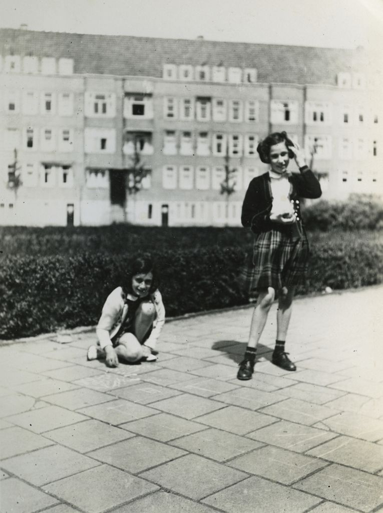 Anne Frank (L) plays with her friend Hanneli Goslar (R) on the Merwedeplein square in Amsterdam, May 1941 (photo credit: AP Photo/Anne Frank House Amsterdam/Anne Frank Fonds Basel photo collections)