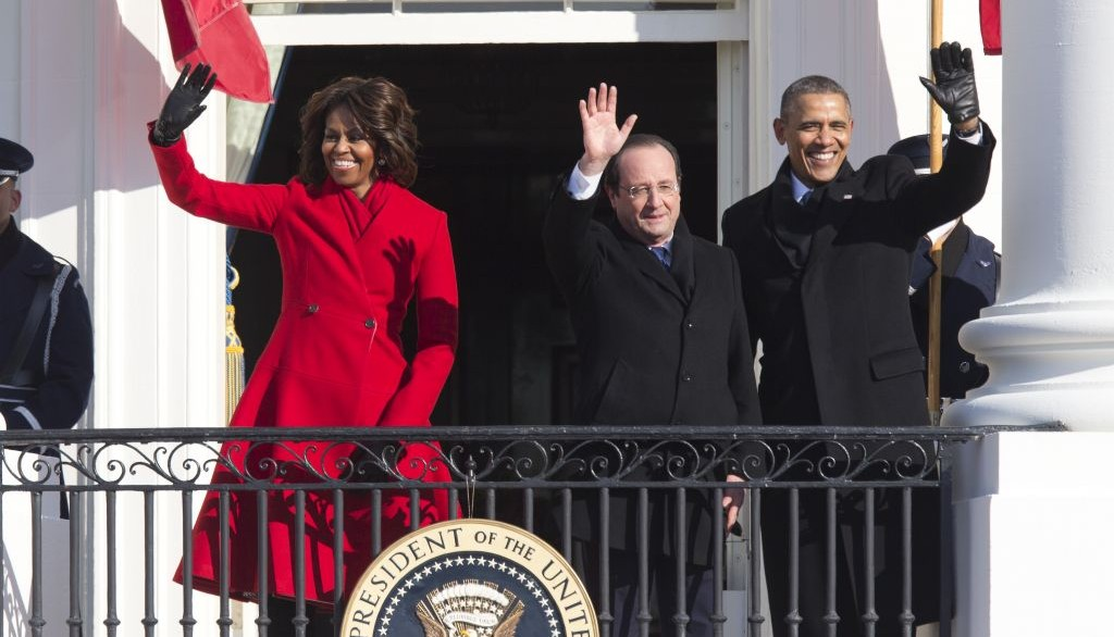 President Barack Obama, first lady Michelle Obama and French President François Hollande wave from the Truman Balcony during a state arrival ceremony at the White House in Washington, Tuesday, Feb. 11, 2014. (photo credit: AP Photo/ J. Scott Applewhite)