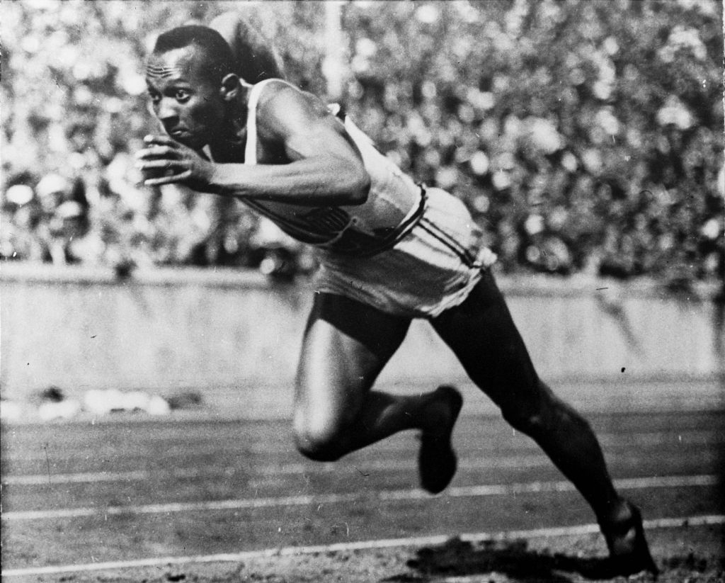 In this 1936 file photo, Jesse Owens of the United States runs in a 200-meter preliminary heat at the 1936 Summer Olympics in Berlin. Owens won four gold medals at the 1936 Berlin Olympics and showed up Adolph Hitler's idea of Aryan supremacy.  (photo credit: AP Photo/File)