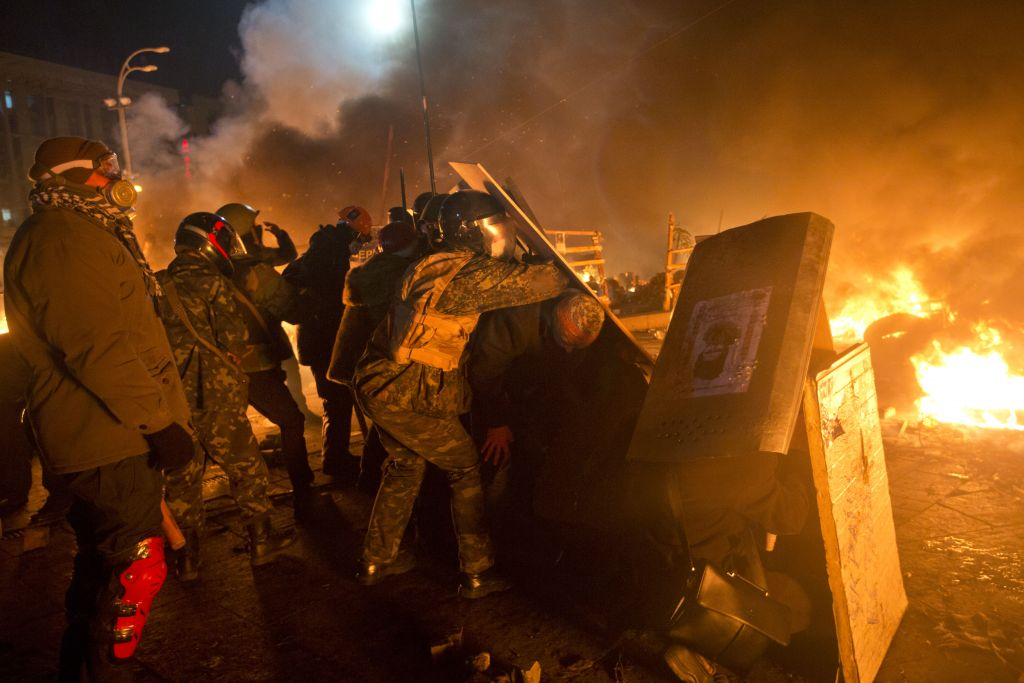 Anti-government protesters clash with riot police in Kiev's Independence Square, the epicenter of the country's current unrest, Kiev, Ukraine, Tuesday, February 18, 2014 (photo credit: AP/Efrem Lukatsky)