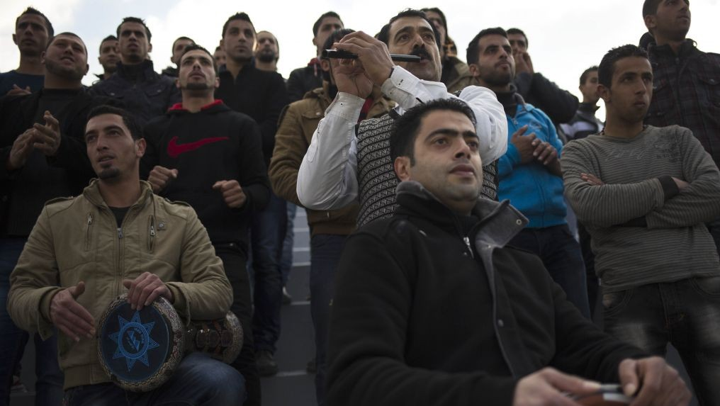 In this Friday Feb. 7, 2014 photo, Wadi al-Nees supporters cheer during a league game in Hebron, West Bank. (photo credit: AP Photo/Dusan Vranic)