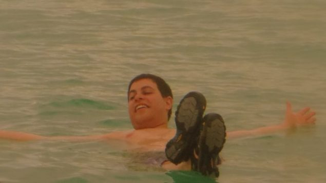 Lindsey Cohen, floating happily on the Dead Sea. Courtesy Jewish Child Care Association