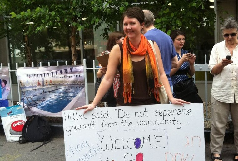 A Jewish Voice for Peace activist protests outside New York City's 14th Street Y in May 2012 after the Jewish institution canceled a 'Go and Learn' event organized by the group's youth arm that was scheduled for a rented room in the Y's building. (Courtesy of Jewish Voice for Peace/JTA)
