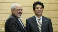 Iranian Foreign Minister Mohammad Javad Zarif (L) shakes hands with Japanese Prime Minister Shinzo Abe (R) at the start of talks at Abe's official residence in Tokyo on March 5, 2014. (photo credit: AFP/ KIMIMASA MAYAMA)
