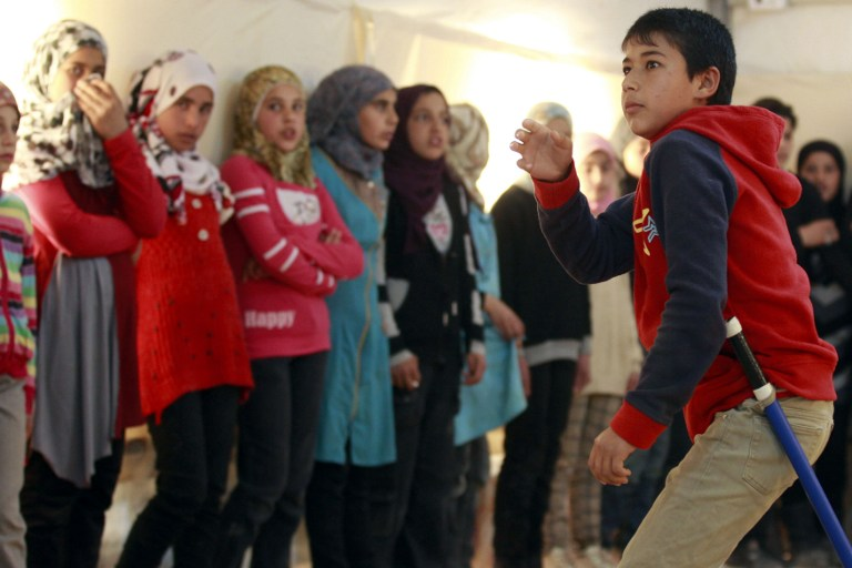 Syrian refugee children at a rehearsal of King Lear, at the Zaatari camp in Jordan, March 8, 2014 (photo credit: AFP/Khalil Mazraawi)