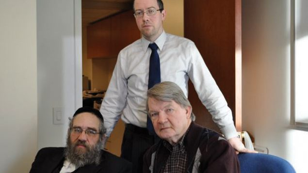 Sam Kellner, seated at left, with attorneys Michael Dowd and Niall MacGiollabhui. Hella Winston