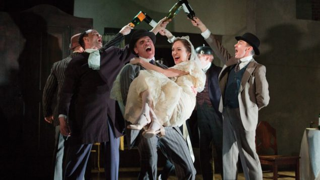 """Michael Park and Laura Osnes, foreground, in scene from """"A Threepenny Opera,"""" directed by Martha Clarke. Kevin Thomas Garcia"""