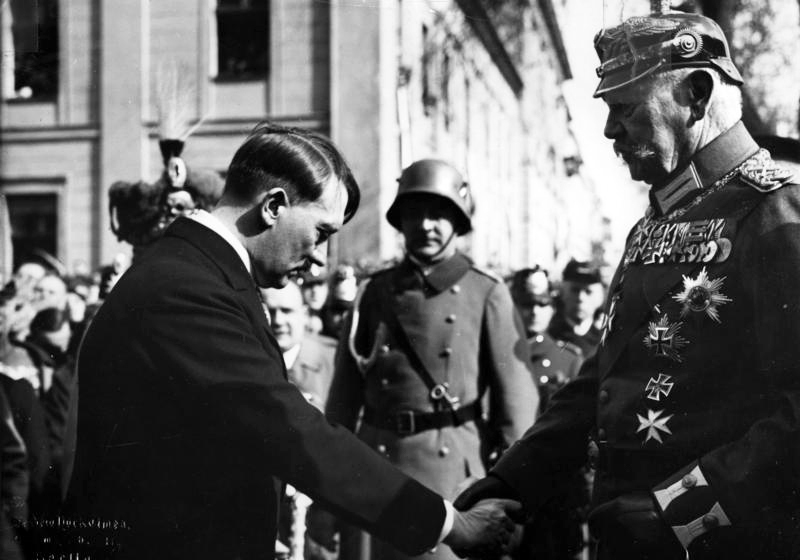Adolf Hitler bows and shakes the hand of Paul von Hindenburg, March 21, 1933 (photo credit: Theo Eisenhart/Federal German Archive)