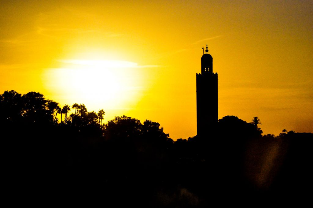 A view of Marrakech's tree tops and its famed Koutoubia Mosque at sunset. (photo credit: Michal Shmulovich)