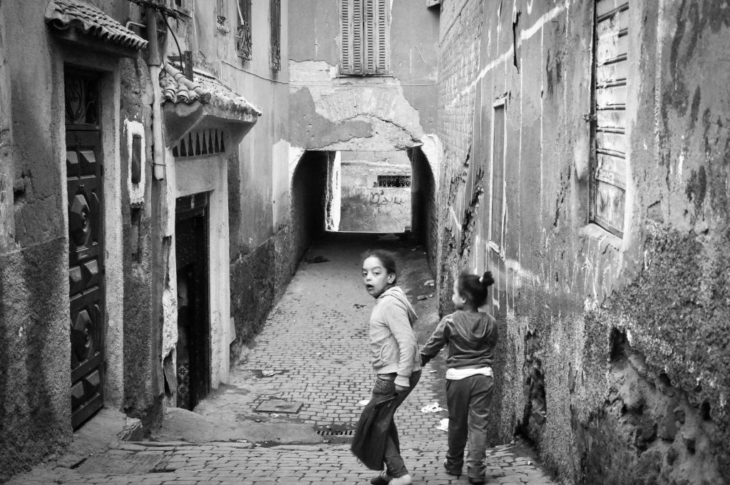 Children run along the walkways of the mellah. The old Jewish quarter is discernible by its narrow, rundown alleys. (photo credit: Michal Shmulovich)
