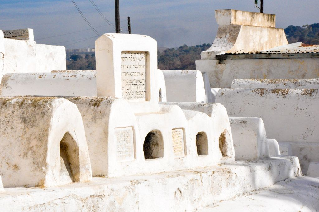 The Jews in Fez had a mixed existence -- at times, the community flourished, as it did during its golden age between the 9th and 11th centuries CE. During other periods, Jews were subjected to violent uprisings, and were expelled and killed. Pictured here are the burial sites of important Moroccan Jews, as evidenced by the large gravestones. (photo credit: Michal Shmulovich)