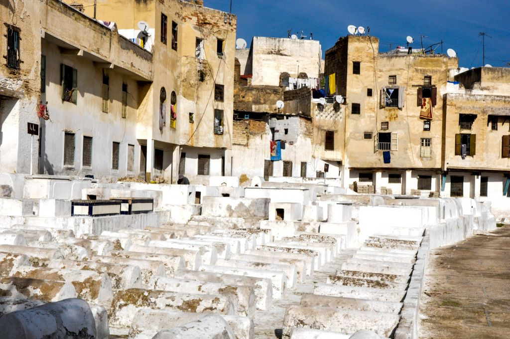 A view of the Jewish cemetery in Fez, with homes in the background. (photo credit: Michal Shmulovich)