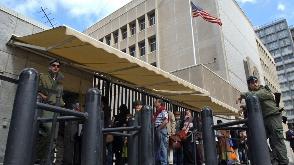 Israelis waiting for US visas line up at the US Embassy in Tel Aviv. (photo credit: AP/Eitan Hess-Ashkenazi/File)