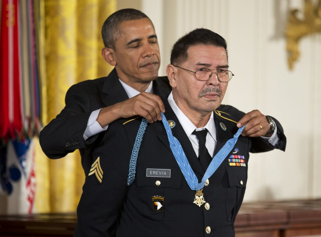 US President Barack Obama awards Army Spc. Santiago Erevia the Medal of Honor during a ceremony at the White House in Washington, Tuesday, March 18, 2014 (photo credit: AP/Manuel Balce Ceneta)