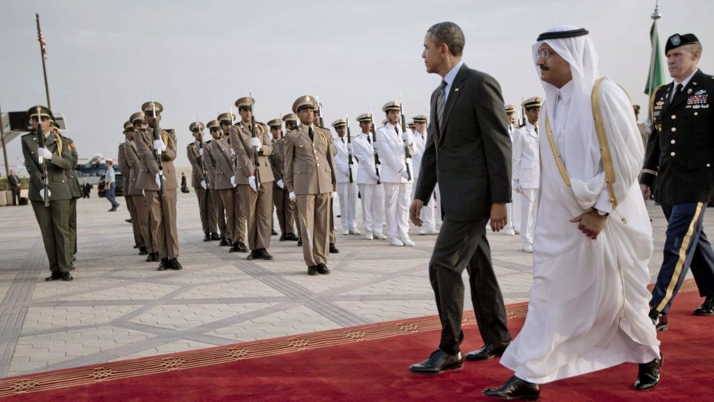 US President Barack Obama walks past an honor guard during an arrival ceremony at King Khalid International airport in Riyadh, Saudi Arabia, Friday, March 28, 2014. (photo credit: AP/Pablo Martinez Monsivais)