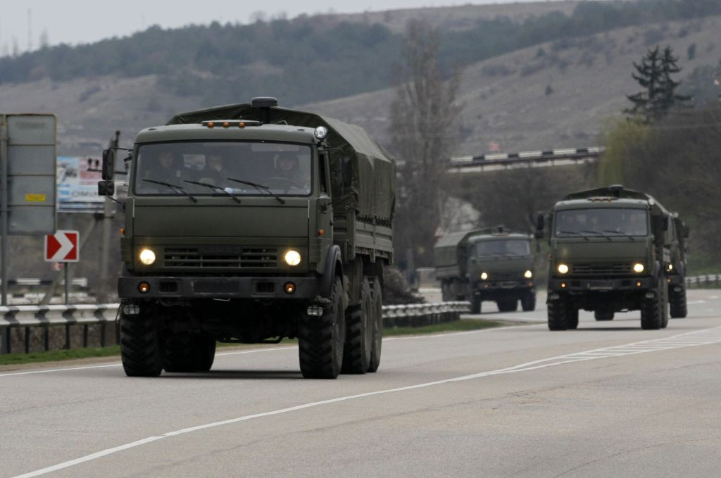 Russian military vehicles heading to the Crimean capital of Simferopol, Sunday, March 2, 2014. (Photo: AP/Darko Vojinovic)