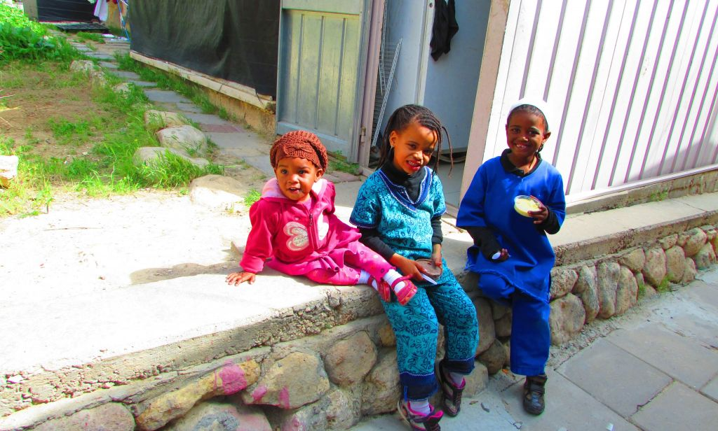Three of the community's children. (photo credit: Debra Kamin/Times of Israel)
