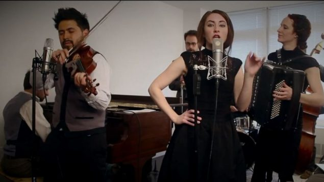 "Anderson and the Postmodern Jukebox band perform ""Talk Dirty""... klezmer style. Photo courtesy YouTube"