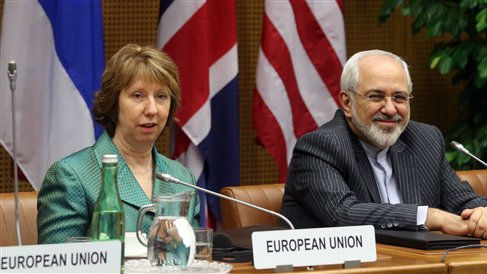 European Union foreign policy chief Catherine Ashton, left, and Iranian Foreign Minister Mohamad Javad Zarif, right, wait for the start of closed-door nuclear talks in Vienna, Austria, Tuesday, March 18, 2014 (photo credit: AP/Ronald Zak)