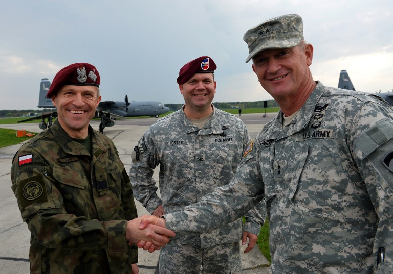 Deputy Commanding General, US Army Europe and Commander, US Army NATO General Richard C Longo, right, shakes hands with Polish general Adam Joks, left, Airborn Brigade Commander as the first American troops arrived at the airport in Swidwin, Poland on April 23, 2014. (photo credit: AFP/Janek Skarzynski)