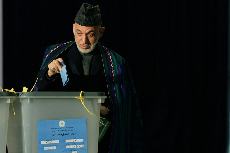 Afghan President Hamid Karzai casts his vote at a local polling station in Kabul on Saturday, April 5, 2014 (photo credit: AFP/Wakil Kohsar)