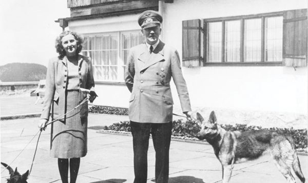 Eva Braun with Hitler, walking their dogs. Wikimedia Commons