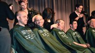 An assembly line of rabbis having their heads shaved last week at convention of Reform rabbis in Chicago. Julie Pelc Adler