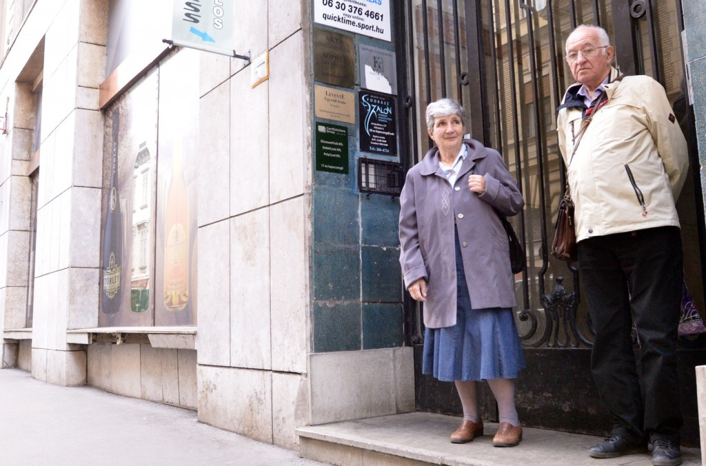 Holocaust survivors Agnes Horvath and Andras Szasz in front of one of Budapest's 2,000 yellow star houses, March 27, 2014. (photo credit: JTA/Cnaan Liphshiz)