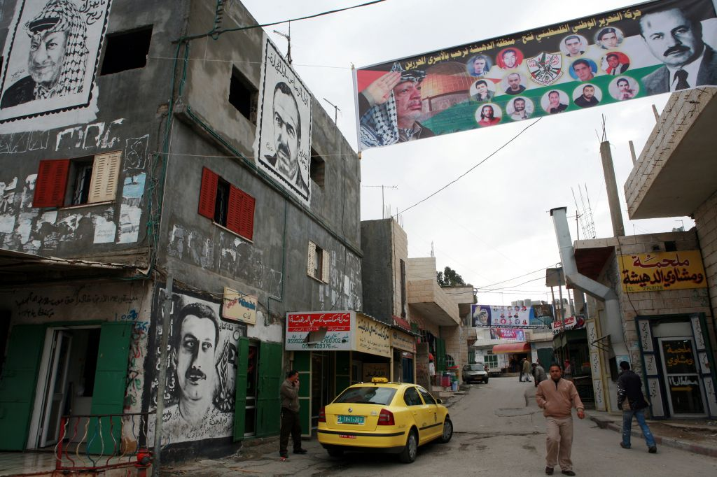 Graffiti and banners are seen in Deheishe refugee camp, near Bethlehem (photo credit: Maya Levin/Flash90/File)