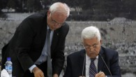 Palestinian Authority President Mahmoud Abbas (right), signs an application to UN and other international agencies, in the West Bank city of Ramallah, on Tuesday, April 1, 2014. (photo credit: Issam Rimawi/Flash90)