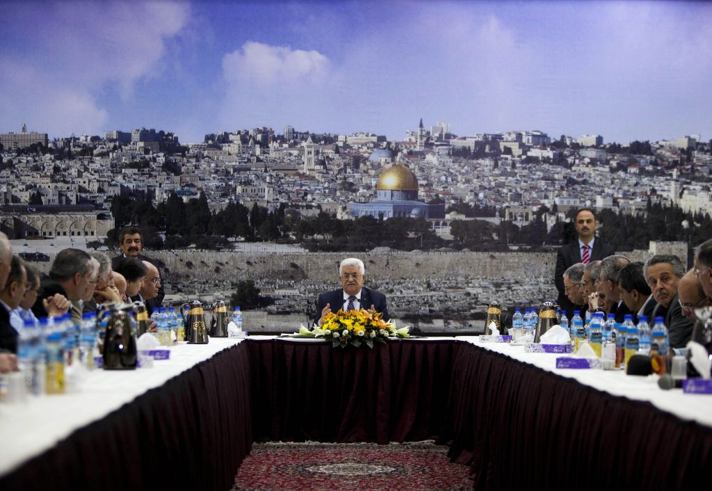 Palestinian Authority President Mahmoud Abbas talks during a leadership meeting in Ramallah, Tuesday, April 1, 2014 (photo credit: AP/Majdi Mohammed)