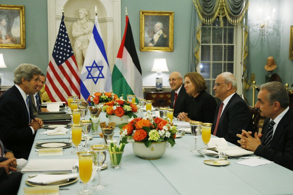 In this July 29, 2013 file photo, Secretary of State John Kerry, left, sits across from Israel's Justice Minister and chief negotiator Tzipi Livni, third right, Palestinian chief negotiator Saeb Erekat, second right, Yitzhak Molcho, an adviser to Prime Minister Benjamin Netanyahu, fourth right, and Mohammed Shtayyeh, aide to PA President Mahmoud Abbas, right, at an Iftar dinner, which celebrates Ramadan, at the State Department in Washington, marking the resumption of Israeli-Palestinian peace talks. (photo credit: AP/Charles Dharapak, File)