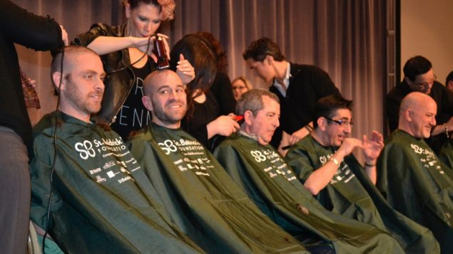 An assembly line of rabbis get their heads shaved at the CCAR convention in Chicago. JTA