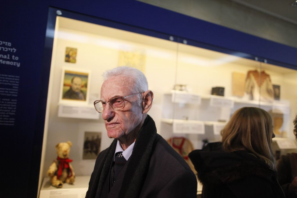 "Holocaust survivor Shlomo Resnik views ""Gathering the Fragments"", Yad Vashem's national campaign to rescue personal items from the Holocaust period (Photo credit: Flash 90)"