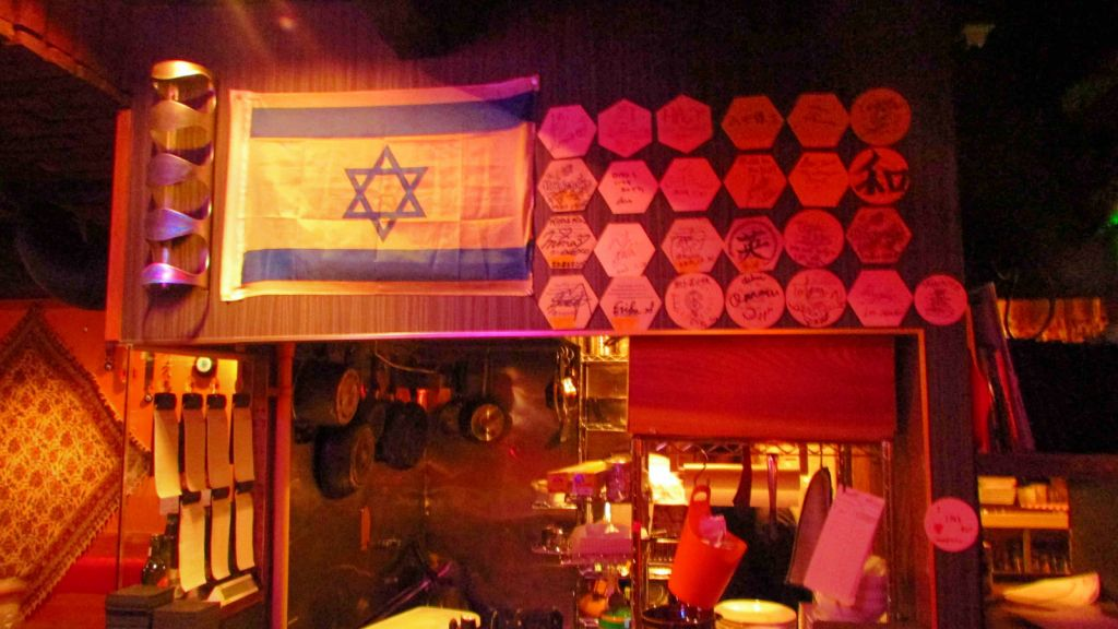 The walls in Middle Mix carry several Middle Eastern flags, including Israel's. (photo credit: Debra Kamin/Times of Israel)