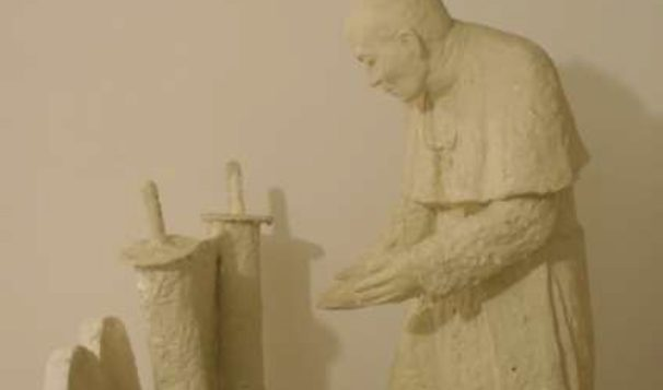 Samuel Willenberg's sculpture of Pope John Paul II, which depicts him reaching out to a Torah scroll.