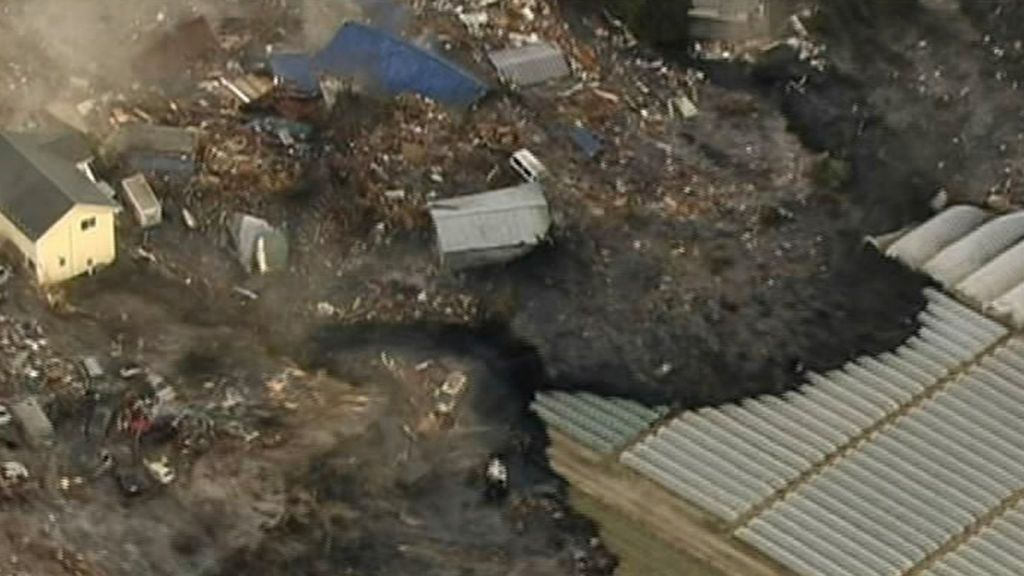 Television footage from March 11, 2011 shows the tsunami swallowing homes in Sendai. (photo credit: AP Photo/NHK TV)