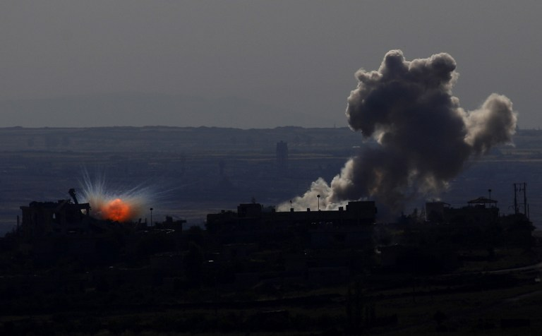 A picture taken on May 11, 2014 from the Israeli-annexed Golan Heights shows smoke billowing from an explosion during clashes between rebels and Syrian pro-government forces in the Syrian town of al-Kahtaniyya. (photo credit:AFP/Jalaa Marey)