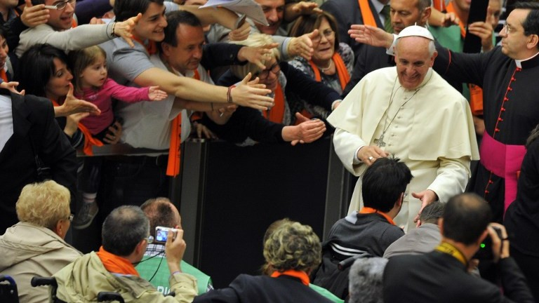 Pope Francis greets people during a meeting with members of the associations founded by Blessed Luigi Novarese at Paul VI audience hall on May 17, 2014 at the Vatican. (Photo credit: AFP Photo/Tiziana Fabi)