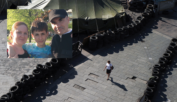 Maidan Square in Kiev. Inset: Sergei Abramov, right, with his wife Yanina and son Victor. Getty Images