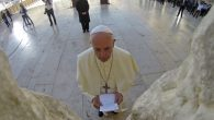 Pope Francis holds a note at the Western Wall. Like many, he left it in a crevice between the site's rocks. Getty Images