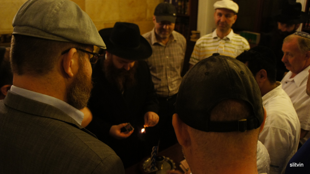 Jews participate in a Havdalah ceremony in a synagogue in Odessa, Ukraine, 2012 (photo credit: CC BY Senia L/Flickr)