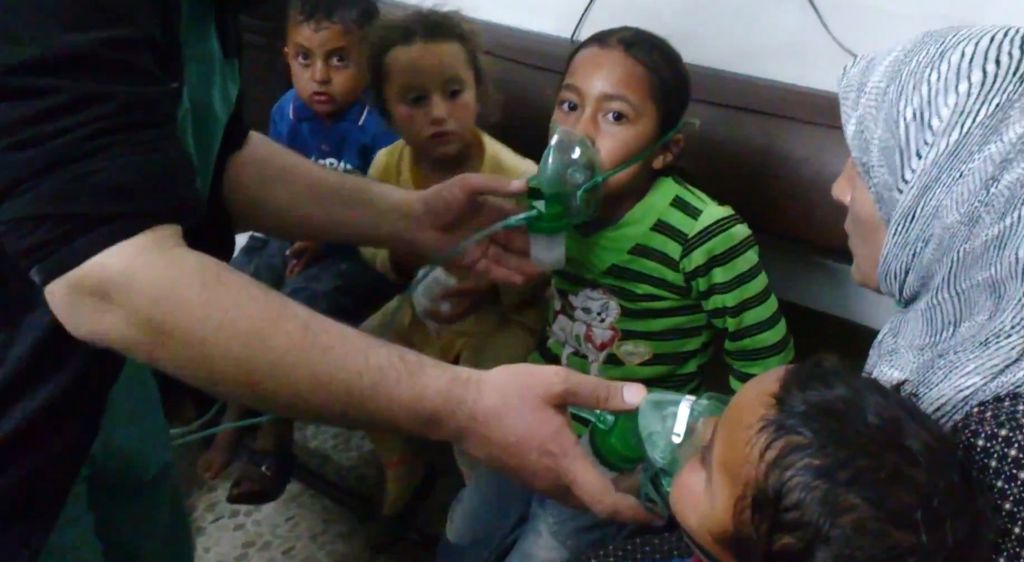 Children receive oxygen in Kfar Zeita, a rebel-held village in Hama province, Syria, after an alleged chemical attack, April 16, 2014 (AP Photo/Shaam News Network)