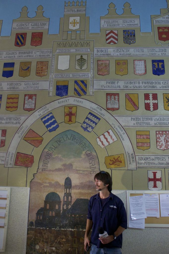 A secco painting in the hallway of the St. Louis French Hospital in Jerusalem showing chivalric coats of arms from the Crusades. (photo credit: Moti Tufeld)