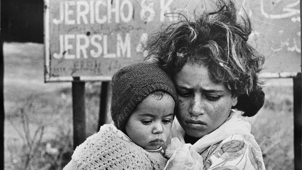 In this 1968 photo, Palestinian refugees have just arrived in Jordan as part of a continuing exodus of Palestinians from the West Bank and Gaza Strip. (photo credit: AP/G.Nehmeh/UNRWA Photo Archives)