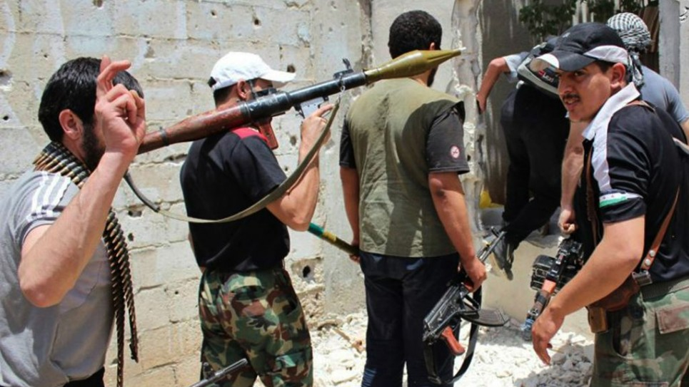 Syrian rebels hold their weapons as they prepare to fight against Syrian troops, in Homs province, June 18, 2012 (photo credit: AP)