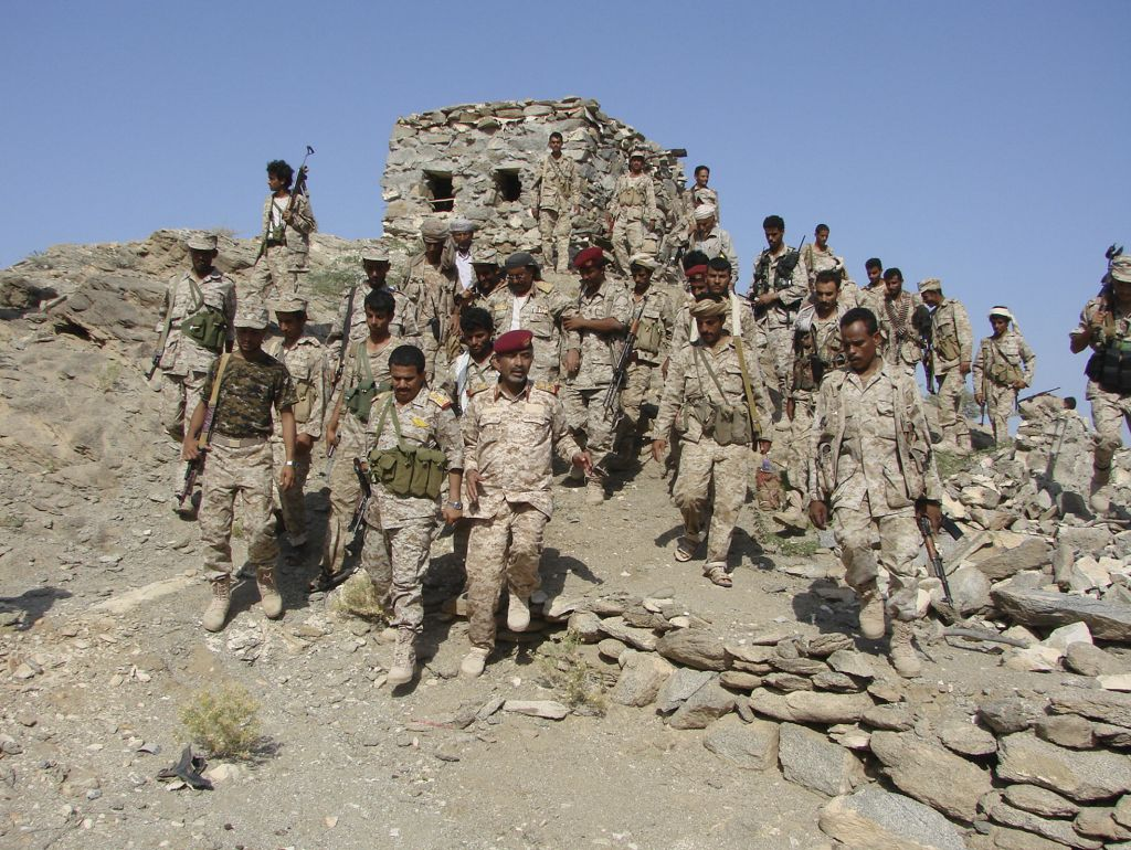 Yemeni troops gather as they take positions at the frontline of fighting with al-Qaeda militants in the southeastern province of Shabwa, Yemen, on Tuesday. (photo credit: AP/Yemen's Defense Ministry)
