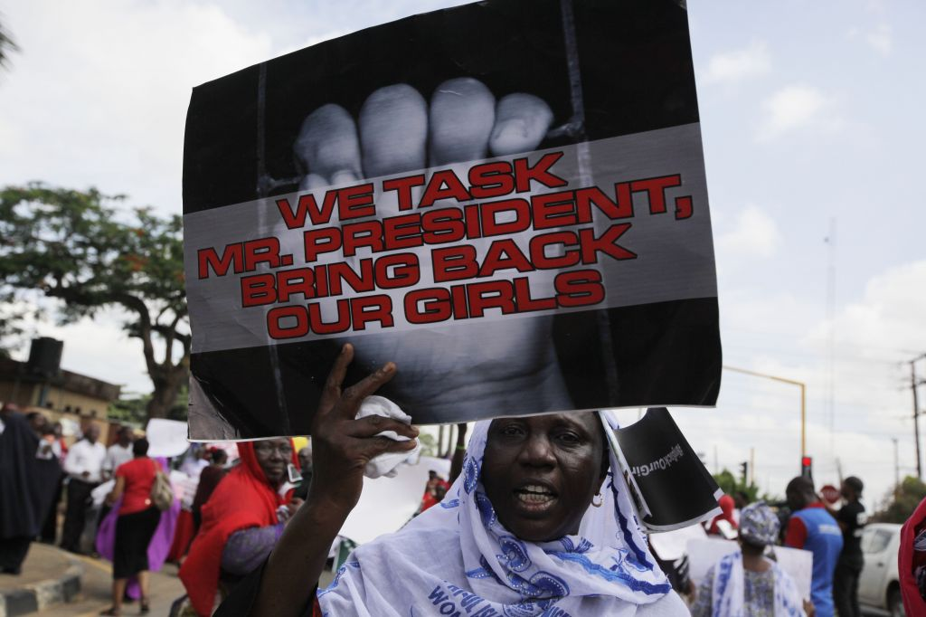 A woman attends a demonstration in Lagos, Nigeria, on Monday, May 5, 2014, urging the government to increase efforts to rescue hundreds of abducted female students from a government secondary school. (photo credit: AP/Sunday Alamba)